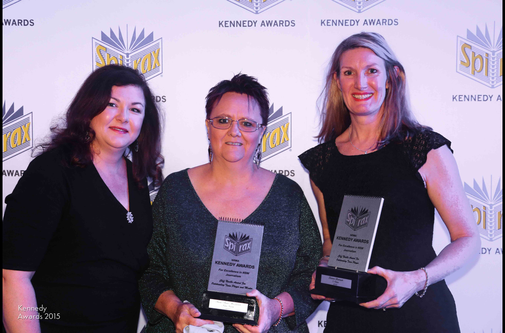 The families of Nine and Seven network news editors Steve McQueen and Leanne Barnett with the posthumous Cliff Neville Awards for Outstanding Team Player