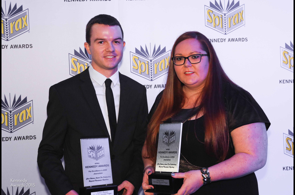 Andrew Pearson and Daisy Huntley of Fairfax Media collect the Chris Watson Award for The Daily Advertiser, Wagga